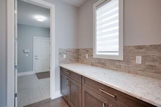 Photo 9: 100 Cranbrook Heights SE in Calgary: Cranston Detached for sale : MLS®# A1140712