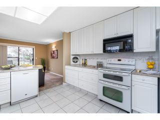 """Photo 13: 121 15153 98 Avenue in Surrey: Guildford Townhouse for sale in """"GLENWOOD VILLAGE AT GUILDFORD"""" (North Surrey)  : MLS®# R2538055"""