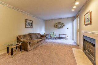 """Photo 2: 105 10091 156 Street in Surrey: Guildford Townhouse for sale in """"Guildford Park"""" (North Surrey)  : MLS®# R2321879"""