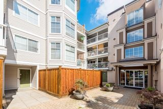 """Photo 1: 312 2678 DIXON Street in Port Coquitlam: Central Pt Coquitlam Condo for sale in """"The Springdale"""" : MLS®# R2307158"""