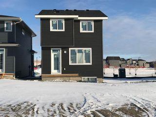 Photo 8: 337 Sundown Road: Cochrane Detached for sale : MLS®# A1049758