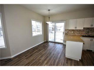 Photo 3: 201 16 POPLAR Avenue: Okotoks Condo for sale : MLS®# C3651941