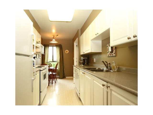 "Main Photo: 310 223 MOUNTAIN Highway in North Vancouver: Lynnmour Condo for sale in ""MOUNTAIN VIEW VILLAGE"" : MLS®# V844629"