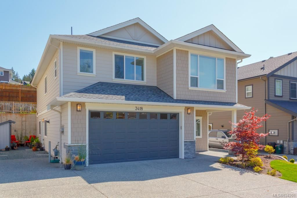 Large Suite Parking to the left of the spacious 2 car garage, level lot and driveway