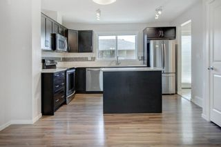 Photo 10: 64 Sunvalley Road: Cochrane Row/Townhouse for sale : MLS®# A1108247