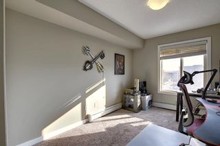 Photo 15: 2413 403 Mackenzie Way SW: Airdrie Apartment for sale : MLS®# A1052642