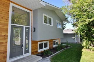 Photo 2: 235 99 Avenue SE in Calgary: Willow Park Residential for sale : MLS®# A1016375