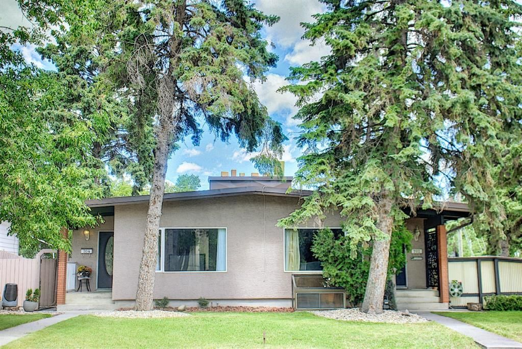 Main Photo: 702/704 53 Avenue SW in Calgary: Windsor Park Duplex for sale : MLS®# A1122930
