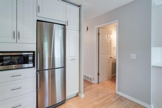 Photo 5: 1407 1 Street NE in Calgary: Crescent Heights Row/Townhouse for sale : MLS®# A1121721