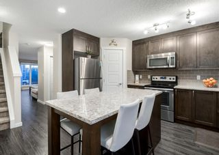Photo 11: 102 2400 RAVENSWOOD View SE: Airdrie Row/Townhouse for sale : MLS®# A1092501