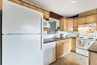 Photo 14: 6 Crystal Shores Cove: Okotoks Row/Townhouse for sale : MLS®# A1080376
