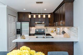 "Photo 5: 401 1215 LANSDOWNE Drive in Coquitlam: Upper Eagle Ridge Townhouse for sale in ""SUNRIDGE ESTATES"" : MLS®# R2603990"