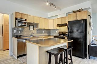 Photo 3: 401 8000 Wentworth Drive SW in Calgary: West Springs Row/Townhouse for sale : MLS®# A1148308