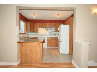 Photo 13: 74 WEST TERRACE Road: Cochrane House for sale : MLS®# C4073559