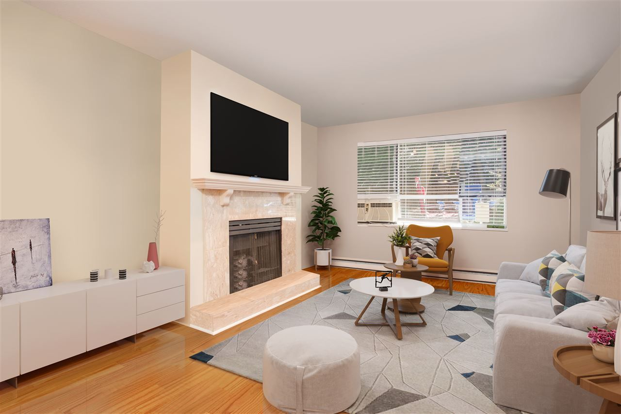 This photo showing the living room has been virtually staged to show the property's full potential