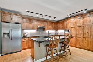 Photo 2: 109 106 Stewart Creek Landing: Canmore Apartment for sale : MLS®# A1126423