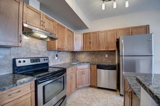 Photo 14: 304 132 1 Avenue NW: Airdrie Apartment for sale : MLS®# A1091993