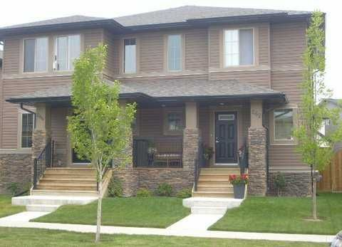 This half-duplex has great curb appeal with exterior stone. You must see the inside to appreciate the finishing and quality of life
