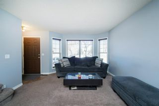 Photo 4: 26 Mt Aberdeen Link SE in Calgary: McKenzie Lake Detached for sale : MLS®# A1095540