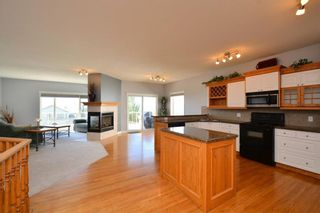 Photo 7: 303 GLENEAGLES View: Cochrane House for sale : MLS®# C4130061