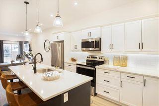 Photo 7: 90 Prairie Crossings Court in Niverville: R07 Condominium for sale : MLS®# 202122455