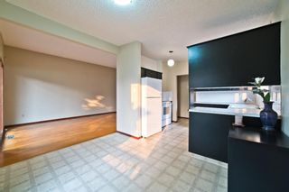 Photo 9: 51 Holland Street NW in Calgary: Highwood Semi Detached for sale : MLS®# A1131163
