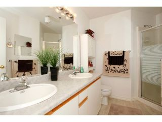 "Photo 13: 311 5955 177B Street in Surrey: Cloverdale BC Condo for sale in ""WINDSOR PLACE"" (Cloverdale)  : MLS®# F1433073"