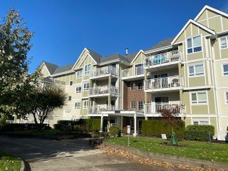 "Photo 1: 307 20189 54 Avenue in Langley: Langley City Condo for sale in ""CATALINA GARDENS"" : MLS®# R2512331"