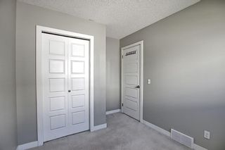 Photo 26: 166 PANTEGO Lane NW in Calgary: Panorama Hills Row/Townhouse for sale : MLS®# A1110965