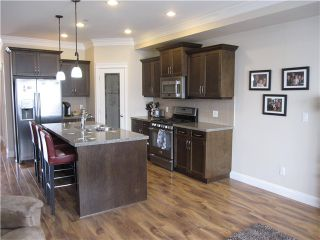 """Photo 4: 23760 111A Avenue in Maple Ridge: Cottonwood MR House for sale in """"FALCON HILL"""" : MLS®# V1121114"""