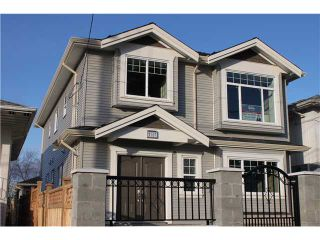 Photo 1: 7657 DAVIES Street in Burnaby: Edmonds BE House for sale (Burnaby East)  : MLS®# V928171