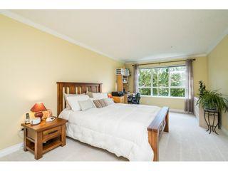 "Photo 15: 228 13880 70 Avenue in Surrey: East Newton Condo for sale in ""Chelsea Gardens"" : MLS®# R2563447"