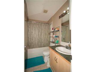 Photo 12: 1001 111 TARAWOOD Lane NE in Calgary: Taradale House for sale : MLS®# C4059766