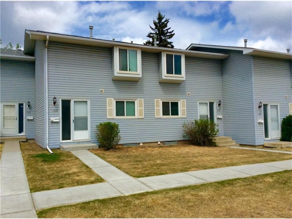 Main Photo: 108 4810 40 Avenue SW in Calgary: Glamorgan Row/Townhouse for sale : MLS®# A1060323