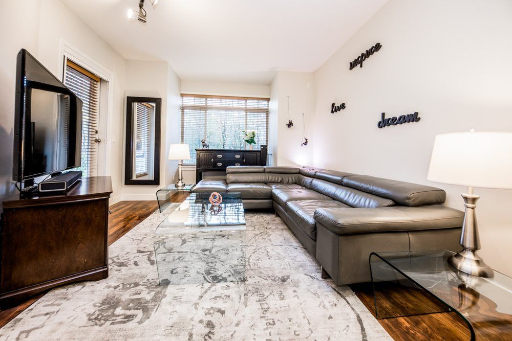 9' ceilings contributes to the bright open concept of this 4 year old garden level home.