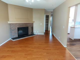 Photo 6: 2 Edgedale Court NW in Calgary: Edgemont Semi Detached for sale : MLS®# A1129985