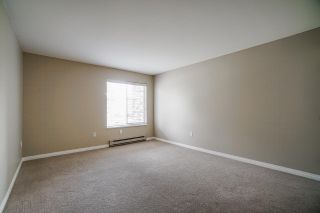 """Photo 12: 102 5379 205 Street in Langley: Langley City Condo for sale in """"Heritage Manor"""" : MLS®# R2447555"""