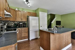 Photo 7: 93 Rocky Vista Circle NW in Calgary: Rocky Ridge Row/Townhouse for sale : MLS®# A1071802