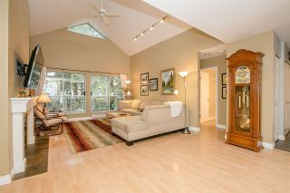 """Photo 1: 404 2733 ATLIN Place in Coquitlam: Coquitlam East Condo for sale in """"ATLIN COURT"""" : MLS®# R2232992"""