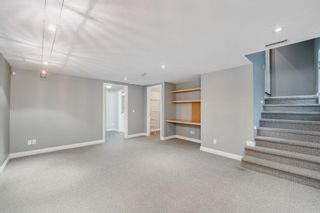 Photo 23: 29 Somme Boulevard SW in Calgary: Garrison Woods Row/Townhouse for sale : MLS®# A1129180