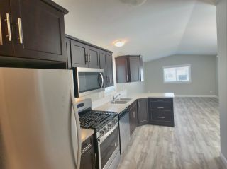 """Photo 2: 22 24330 FRASER Highway in Langley: Otter District Manufactured Home for sale in """"Langley Grove Estates"""" : MLS®# R2390196"""
