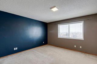 Photo 21: 105 Rocky Ridge Court NW in Calgary: Rocky Ridge Row/Townhouse for sale : MLS®# A1069587