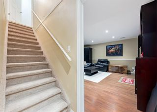 Photo 35: 218 950 ARBOUR LAKE Road NW in Calgary: Arbour Lake Row/Townhouse for sale : MLS®# A1136377