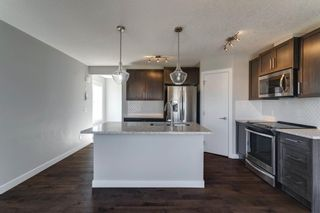 Photo 9: 527 Sage Hill Grove NW in Calgary: Sage Hill Row/Townhouse for sale : MLS®# A1082825