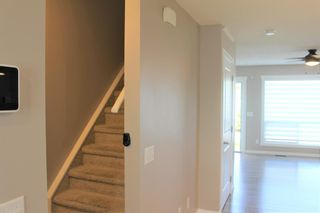 Photo 21: 1404 Clover Link: Carstairs Row/Townhouse for sale : MLS®# A1073804