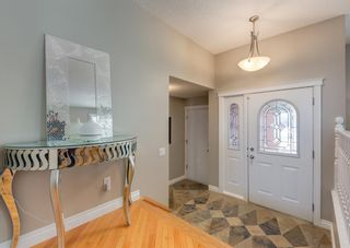 Photo 4: 848 Coach Side Crescent SW in Calgary: Coach Hill Detached for sale : MLS®# A1082611