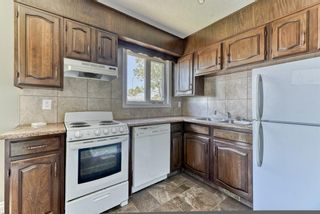 Photo 5: 218 Storybook Terrace NW in Calgary: Ranchlands Row/Townhouse for sale : MLS®# A1126980