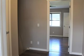Photo 34: 1404 Clover Link: Carstairs Row/Townhouse for sale : MLS®# A1073804