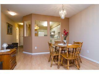 "Photo 6: 106 13860 70 Avenue in Surrey: East Newton Condo for sale in ""Chelsea Gardens"" : MLS®# R2243346"