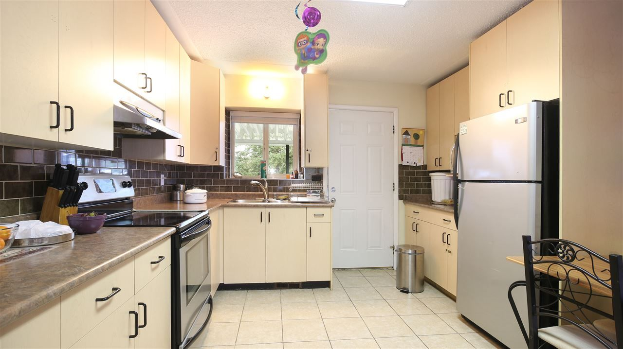 Main Photo: 7136 134 STREET in Surrey: House for sale : MLS®# R2040377